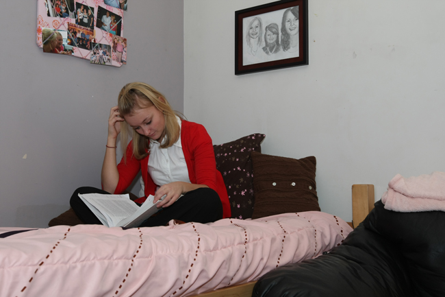 student studying in the dorm